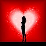 Femmina sexy su un cuore stellato Fotografie Stock
