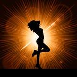 Femmina sexy sulla priorità bassa dello starburst Fotografie Stock Libere da Diritti