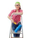 Femmina sorridente con il rullo fotografia stock libera da diritti