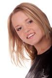 Femmina sorridente del ritratto del primo piano giovane fotografia stock