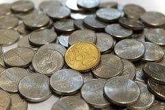 Femtio eurocent mynt på en hög av rubel Fotografering för Bildbyråer
