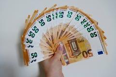 Femtio eurosedlar p? en vit bakgrundsn?rbild royaltyfria foton