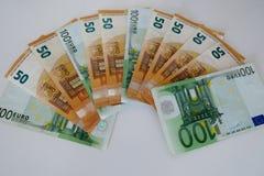 Femtio och hundra euro p? en vit bakgrund royaltyfri foto