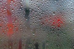 Fenêtre avec des baisses de l'eau Photographie stock