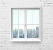 Fenêtre avec la vue de gratte-ciel Images stock
