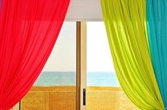 Fenêtre colorée avec la vue de mer Photo libre de droits