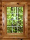 Fenêtre de carreau de mur de rondin Photos stock