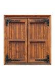 Fenêtre en bois de tissu pour rideaux avec des volets fermés Image stock