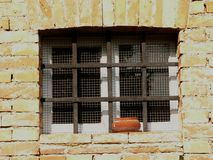 Fenêtre et barres Photographie stock libre de droits
