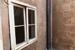 Fenêtre et mur plâtré Photographie stock libre de droits