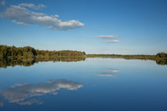 Fen with bright blue sky and clouds reflected in the water Stock Photography