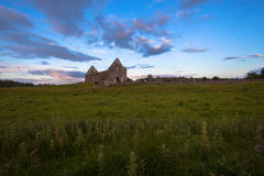 Fenagh Abbey Structure Ireland History. The Fenagh Abbey Building structure with no roof in the North West of Ireland. The wide angle photo image captured early Stock Image