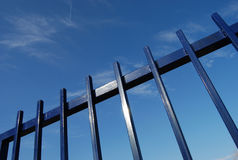 Fence 11. Metal fence over blue sky Royalty Free Stock Photo