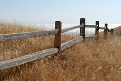 Fence. Rustic fence in the field royalty free stock photography
