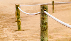 Fence. From the rope and wooden poles in the desert Stock Photos