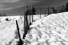 Fence. Old fence on snowy field, horizontally framed shot royalty free stock photo