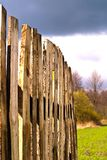 Fence. Old wooden boundary fence with nails on sunny day Stock Image