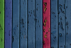 Fence. Blue, red and green aged wooden fence stock photo