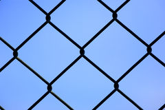 Fence. Pattern of a fence with blue sky as background Stock Image