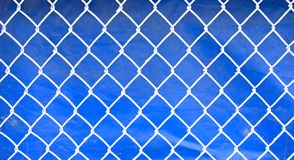 Fence. White fence against blue background Stock Photos