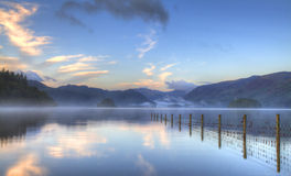Fence. Lake District UK Fence reflections Waterscape Royalty Free Stock Photo