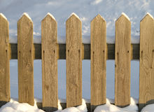 Fence. Detail of wooden fence in winter Stock Photos