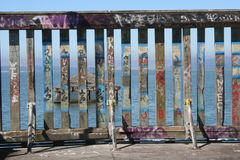 Fence. Painted with graffiti at the end of a fishing pier Stock Photo