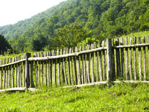 Fence. Old classic nice wooden fence in the summer meadow Stock Photos