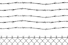 Fence with 5 barbed wires. Wired fence with five barbed wires Royalty Free Stock Photos