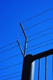 Fence. With barbed wire on top Stock Image