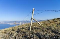Fence of the abandoned military base Stock Photo