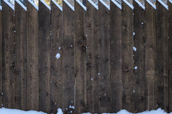 The fence of acute pine logs, close-up Royalty Free Stock Image