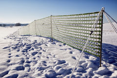 Fence against snowdrift. At the alps Stock Images