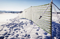 Fence against snowdrift. At the alps Royalty Free Stock Photos