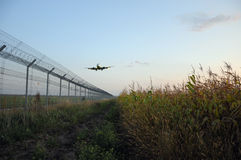 Fence of airport and a plane Stock Image