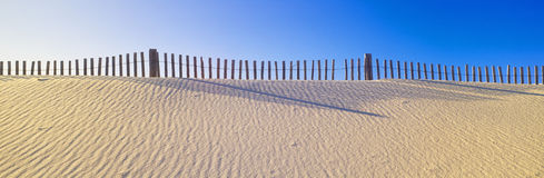 Fence along beach Royalty Free Stock Images