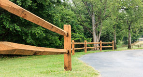 Fence along road to unknown lake. Split rail fence headed toward unknown lake in Charlotte NC Royalty Free Stock Images