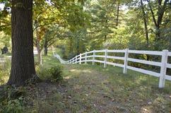 Fence along a rural roadway Stock Photos