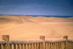 Fence along the sand dunes Royalty Free Stock Photo