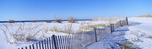 Fence along white sand beach at Santa Rosa Island Stock Photos