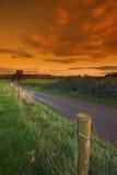 Fence alongside a country lane Stock Photo