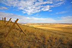 Fence in the American prairie Stock Images