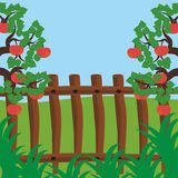 Fence and apple trees Stock Photography