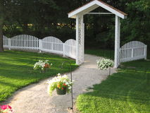 Fence and Arbor. Beautiful arbor, fence and flower path Stock Photography
