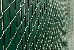 Fence Architecture. A background with a closeup view of the design of a green fence Stock Image