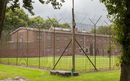Fence around restricted area. Old jail in the Netherlands Royalty Free Stock Photos