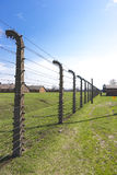 Fence in Auschwitz concentration camp Stock Photo