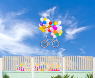 Fence and balloons on blue sky Stock Photo