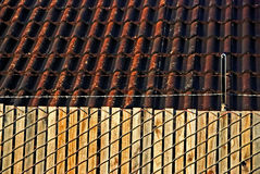 Fence, barb wires and roof Stock Photo