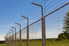 Fence with a barbed wire. Fence with  a barbed wire, metal Royalty Free Stock Photography